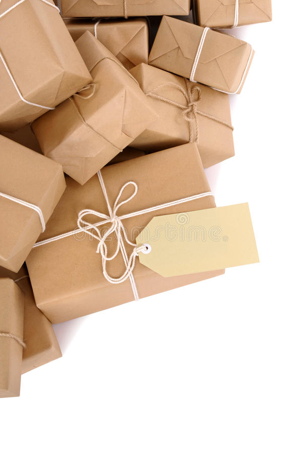 Untidy stack of brown paper parcels with manila label isolated on white background royalty free stock photo