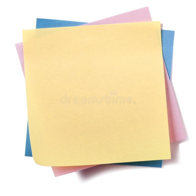 Untidy stack various different colors sticky post notes isolated yellow top stock image