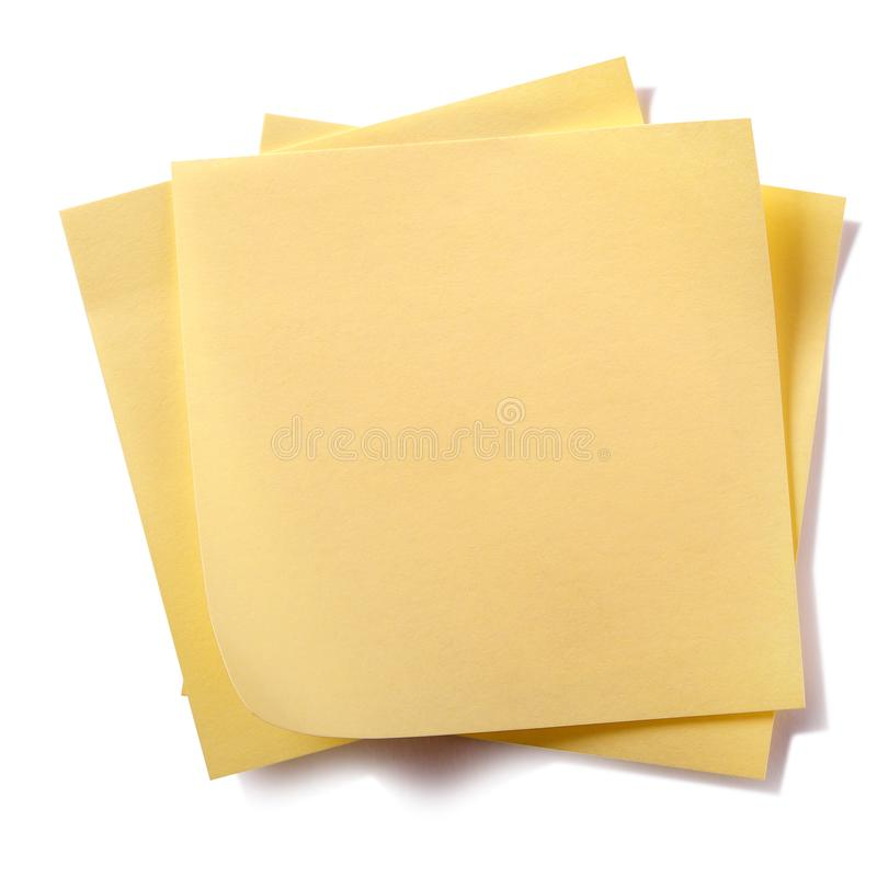 Untidy stack yellow sticky post notes isolated on white background stock image