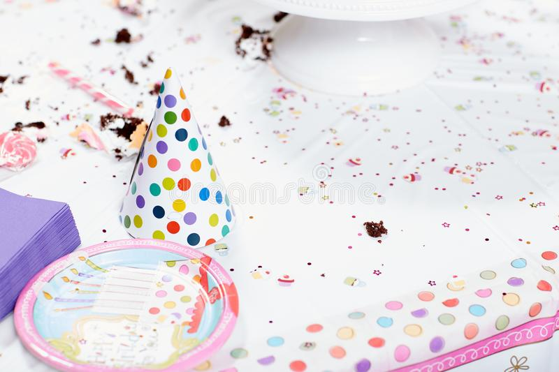 Messy table after birthday party stock photography