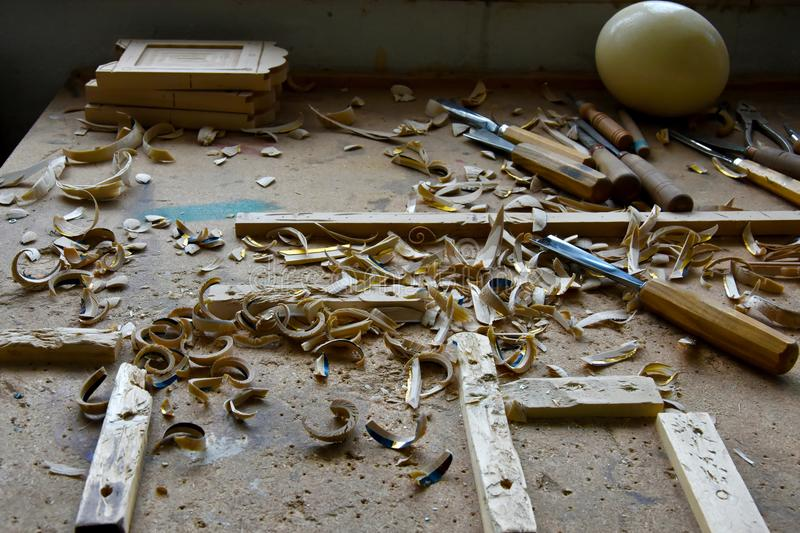 Untidy workplace of a woodcarver royalty free stock photography