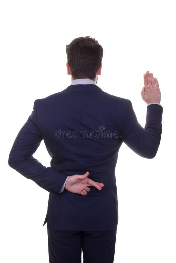 Untrustworthy, encontrando-se, dedos do homem de negócio cruzados fotografia de stock royalty free