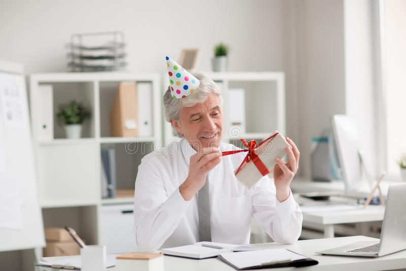 Untying gift-box royalty free stock photo