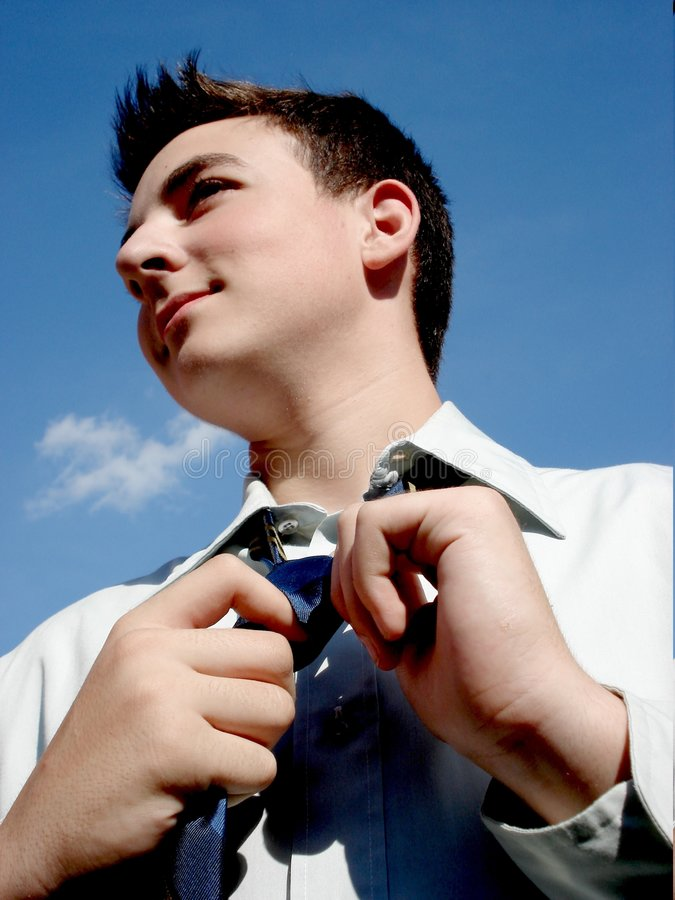 Untying The Tie. Young bussiness man, with his head back royalty free stock images