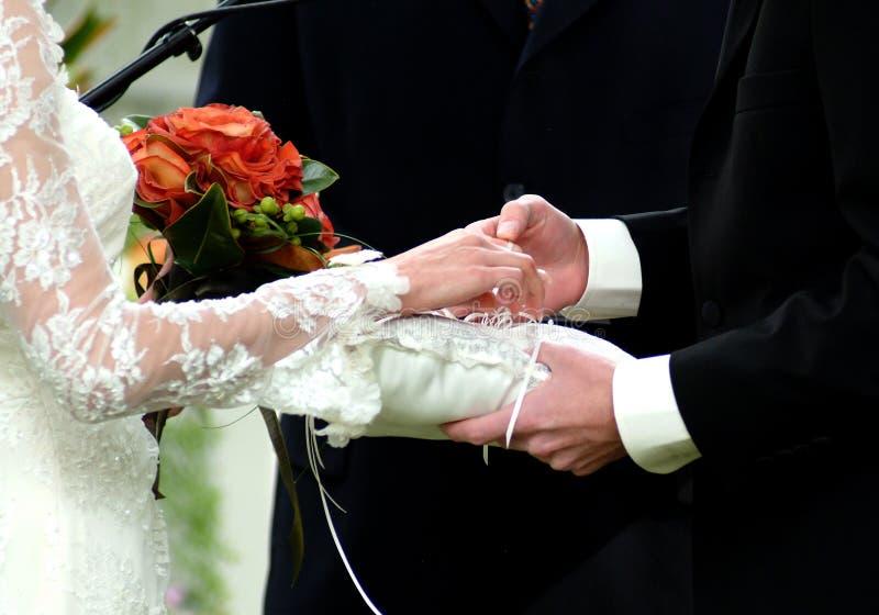 Untying wedding rings stock photo