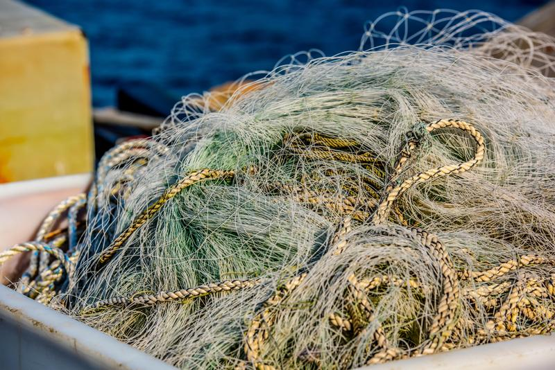 Unused green fishing nets in a pile royalty free stock photos