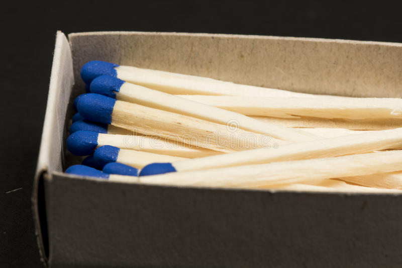 Unused matches with blue head royalty free stock photos