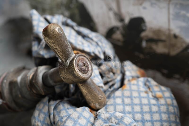 Unused old rusted tap on top of a cloth royalty free stock photography