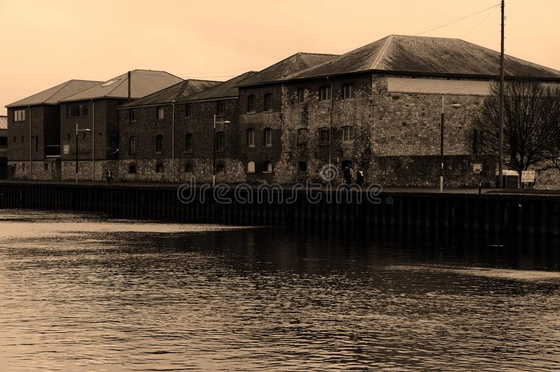 Unused Warehouse from 19th Century at Exeter Quayside. Abandoned warehouses at Exeter quayside used to transship goods from rail to ship stock photography
