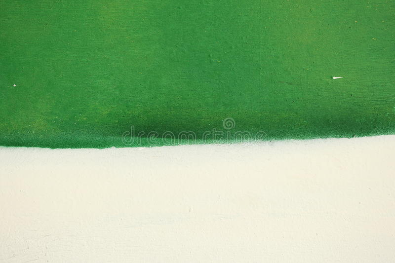 Unusual abstract colorful painted wall background texture. Unusual abstract colorful green and white painted background texture stock photo
