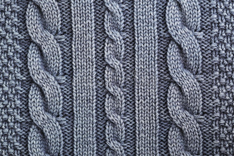 Unusual Abstract knitted pattern background texture. Unusual Abstract handmade grey and blue knitted pattern background texture stock images