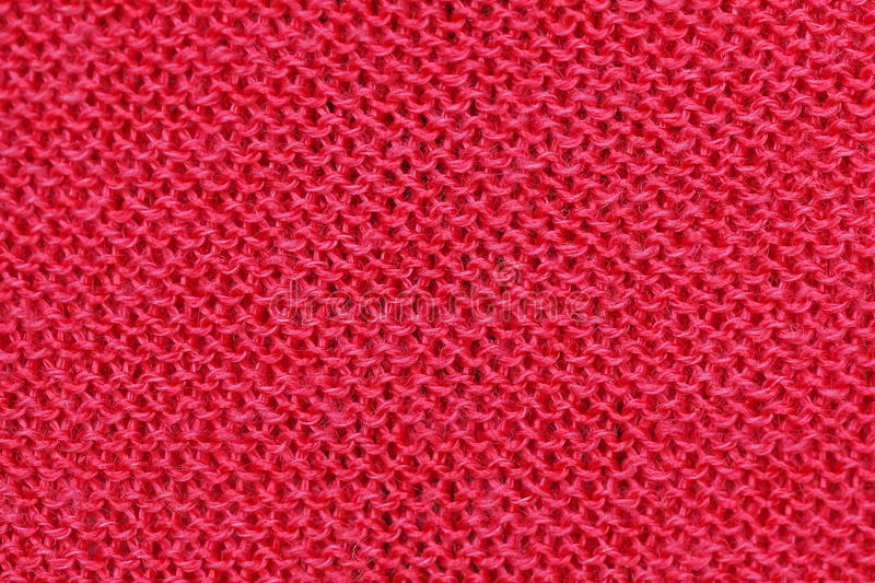 Unusual Abstract knitted pattern background texture. Unusual Abstract handmade red knitted pattern background texture stock photos