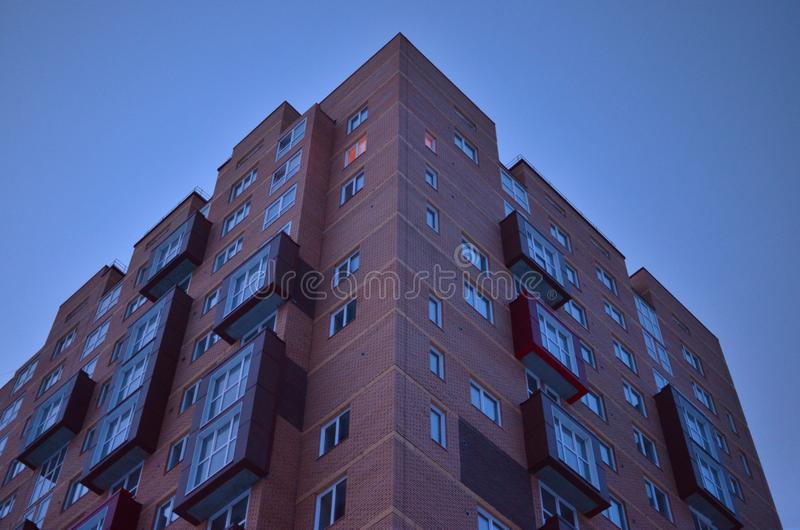 Unusual balconies of a brick building royalty free stock photo
