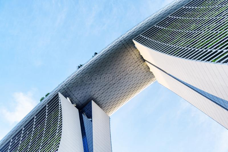 Unusual bottom view of the Marina Bay Sands Hotel, Singapore. Singapore - February 17, 2017: Unusual bottom view of the Marina Bay Sands Hotel. Modern towers and royalty free stock photography