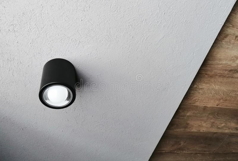 Unusual ceiling with a modern lamp and different levels stock photo