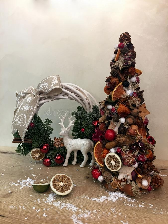 Unusual christmas tree made of natural materials. Atmospheric moody image at winter holiday workshop. Unusual christmas tree made of natural materials. Unusual royalty free stock image