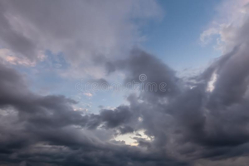 Unusual cloudy skies 0663. Unusual cloudy skies with dramatic grey clouds with some blue sky stock images
