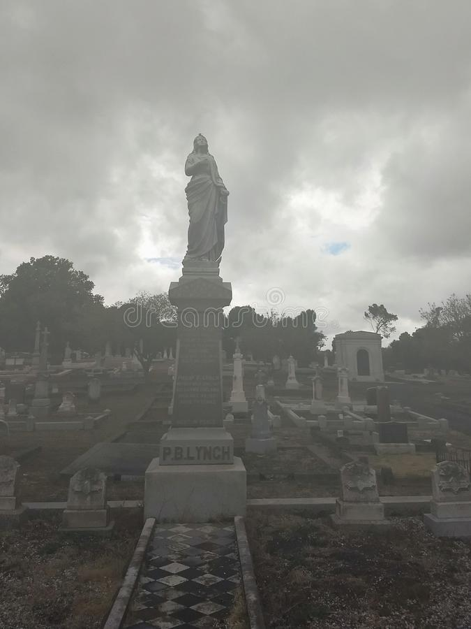 An unusual day at the cemetery in Vallejo California. Eerie, creepy, foggy, statues stock images