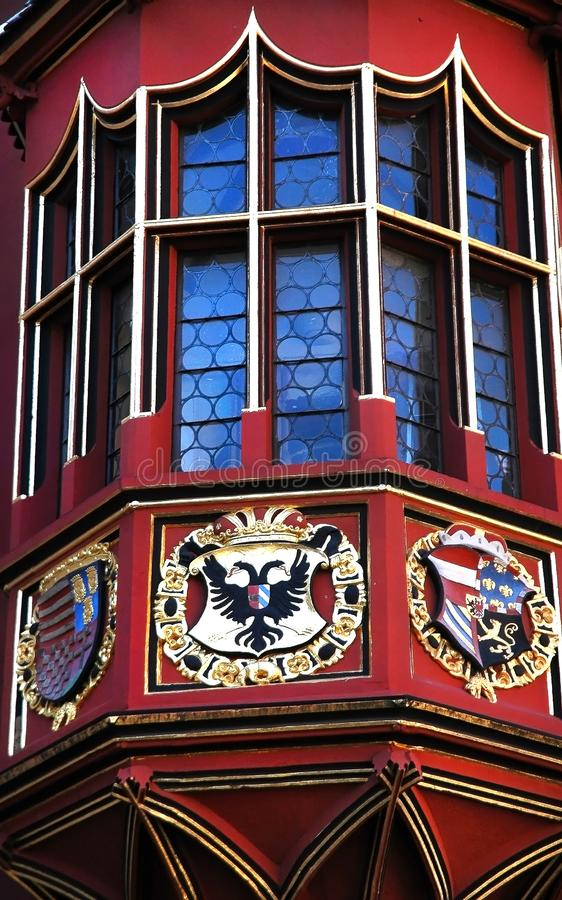 Unusual decorated window and balcony of old Historical Merchants Hall facade, Freiburg im Breisgau, Germany. Amasing colorful details of the Historical Merchants royalty free stock photo