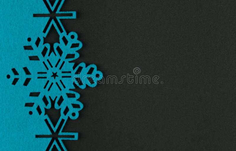 Unusual design christmas background with blue snowflakes. And copy space on dark grey background stock photos