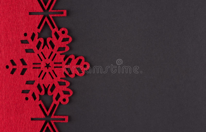 Unusual design christmas background with red snowflakes and copy space. On dark grey background royalty free stock photos