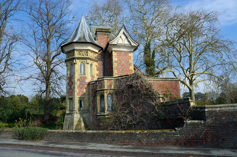 Gothic style house with turret. Unusual gothic style design of this house in the UK incorporating the pointed turret of the Victorian gothic revivalist period royalty free stock image