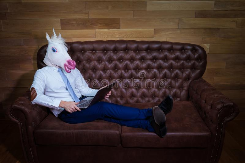 Unusual man working at home office. Freaky young manager royalty free stock photography
