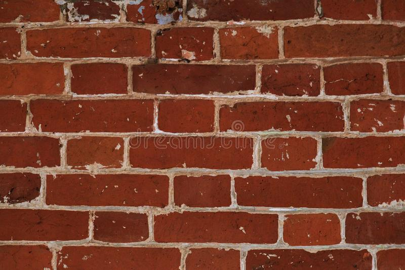 Unusual masonry of red bricks, ancient stone texture royalty free stock photos