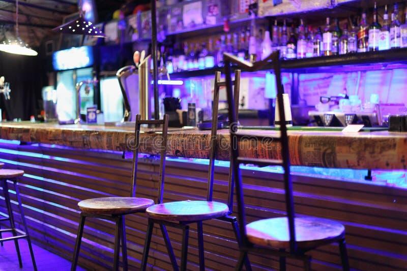 Unusual metal bar stools stand near bar counter stock image