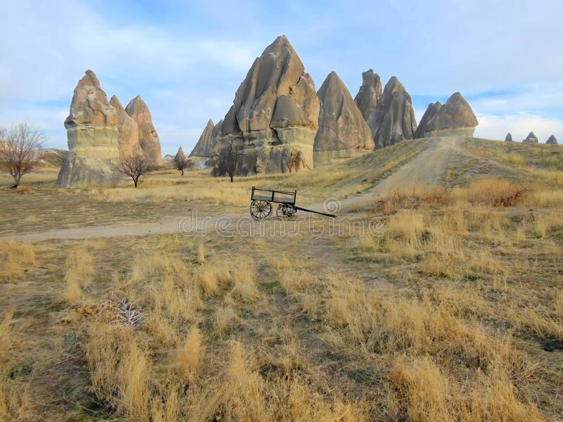 Unusual natural rock formations in Turkey. Unusual natural rock formations and pillars in the Cappadocia region of Turkey royalty free stock photography
