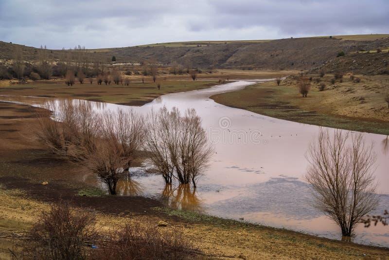 Unusual orange color of the water in the river. Pueblos rojos, Castilla y Leon, Spain stock images