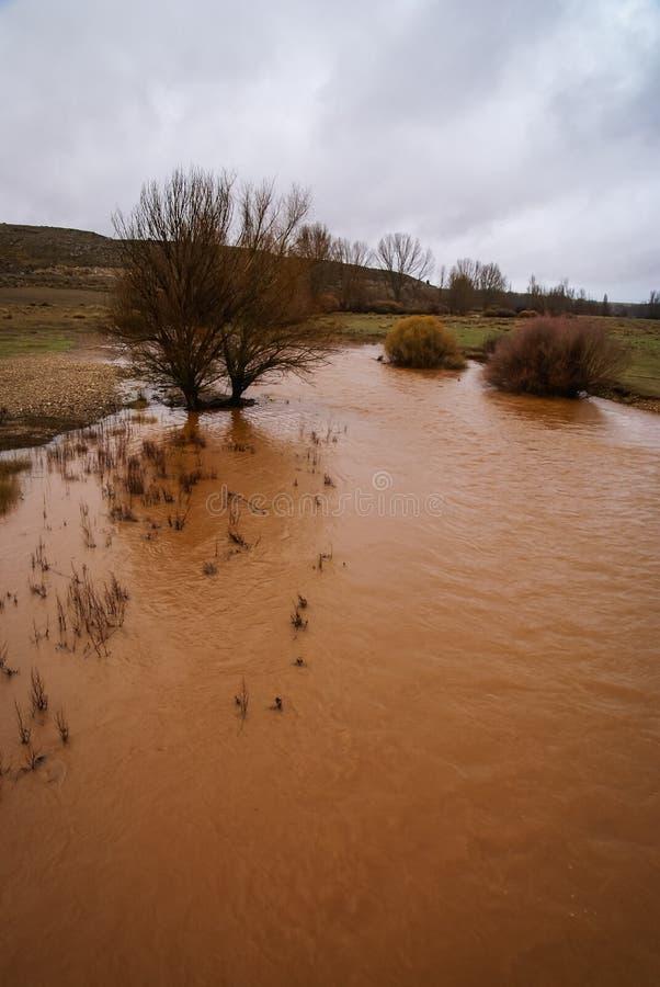 Unusual orange color of the water in the river. Pueblos rojos, Castilla y Leon, Spain stock photos