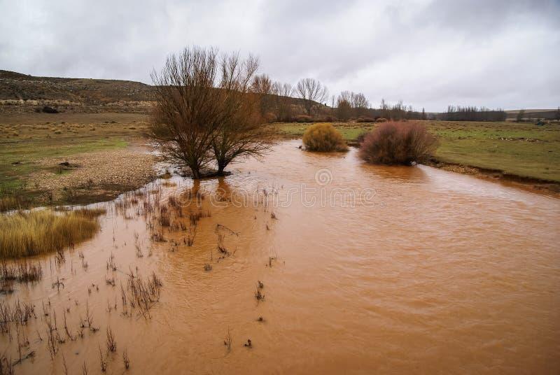 Unusual orange color of the water in the river. Pueblos rojos, Castilla y Leon, Spain stock photo