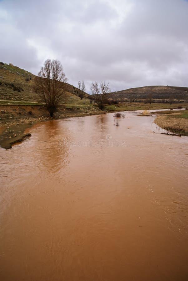 Unusual orange color of the water in the river. Pueblos rojos, Castilla y Leon, Spain royalty free stock image