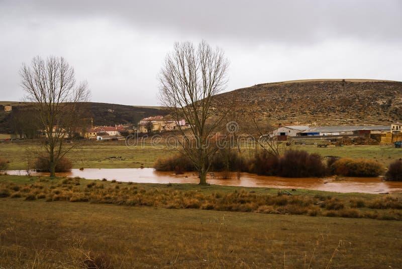 Unusual orange color of the water in the river. Pueblos rojos, Castilla y Leon, Spain stock image