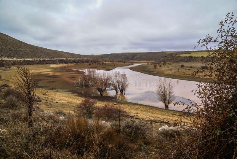 Unusual orange color of the water in the river. Pueblos rojos, Castilla y Leon, Spain royalty free stock images