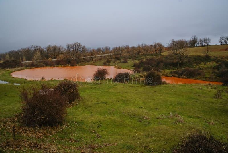 Unusual orange color of the water in the small lake. Pueblos rojos, Castilla y Leon, Spain stock photos