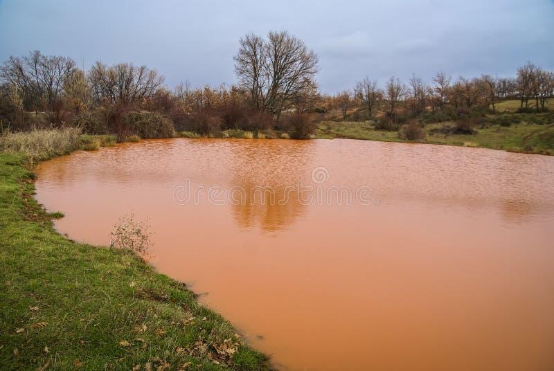 Unusual orange color of the water in the small lake. Pueblos rojos, Castilla y Leon, Spain stock images