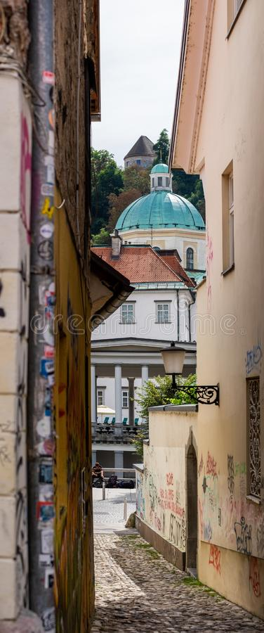 Unusual panoramic view on Ljubljana Cathedral (St. Nicholas's Church), also named St. Nicholas' Cathedral. Slovenia stock photography