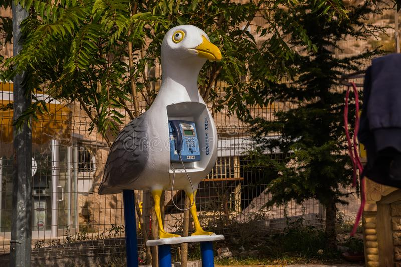 Unusual phone machine on the street in the form of a bird Seagull. Uchisar. Cappadocia, Turkey royalty free stock photography