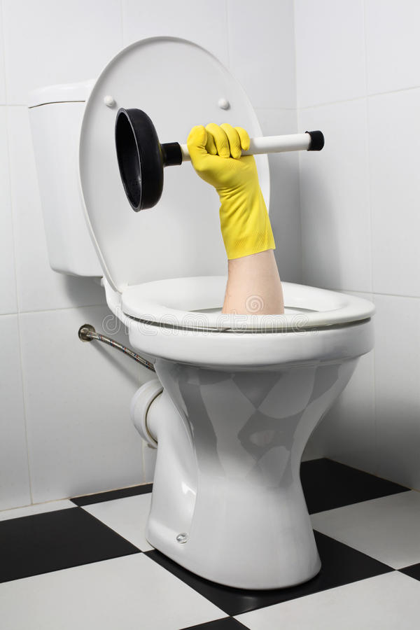 Unusual plumber with plunger (joke) stock photos