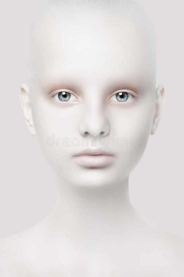 Unusual portrait of a young girl. Fantastic appearance. White skin. Head close-up. Creative design stock image