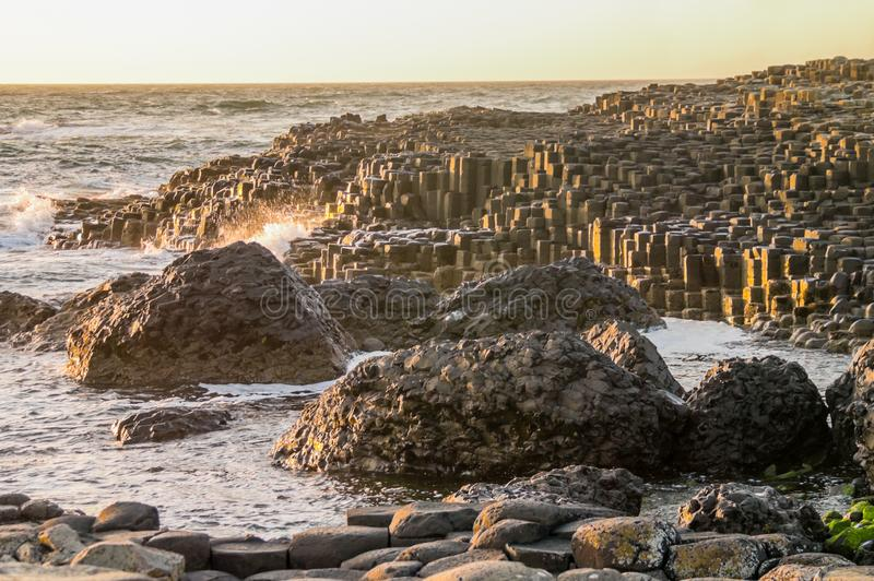 Unusual rock formations on the Giant`s Causeway, Northern Ireland. On a summer`s evening at sunset royalty free stock images