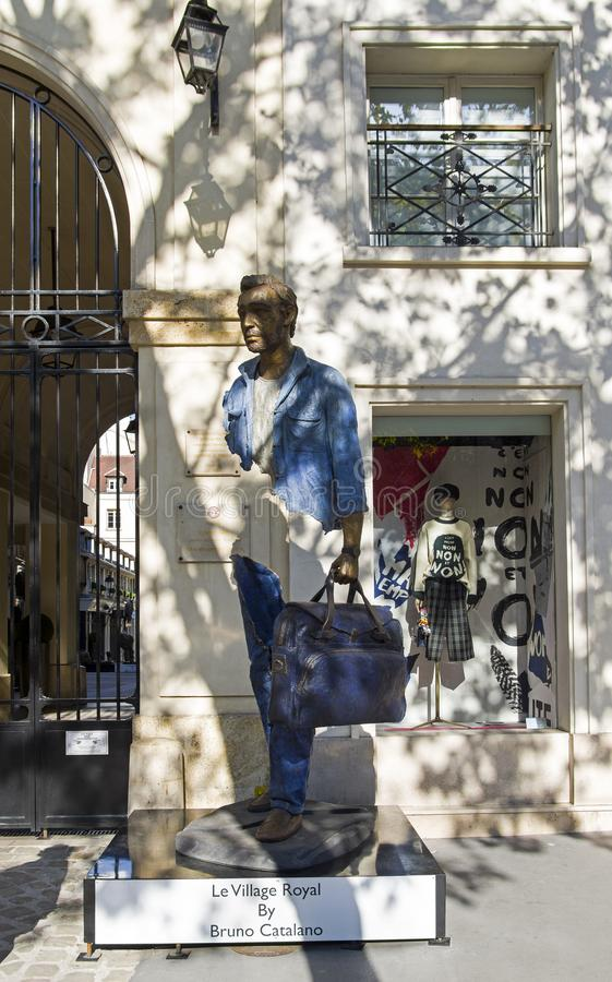 Unusual sculpture in the center of Paris. Paris, France - September 2, 2018: Street exposure of the artworks of Bruno Catalano on the Parisian shopping street Le royalty free stock photography