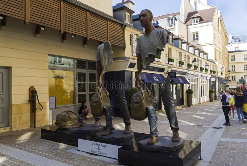 Unusual sculpture in the center of Paris. Paris, France - September 3, 2018: Street exposure of the artworks of Bruno Catalano on the Parisian shopping street Le stock photos