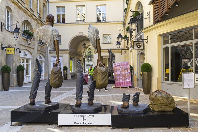 Unusual sculpture in the center of Paris. Paris, France - September 3, 2018: Street exposure of the artworks of Bruno Catalano on the Parisian shopping street Le royalty free stock photo