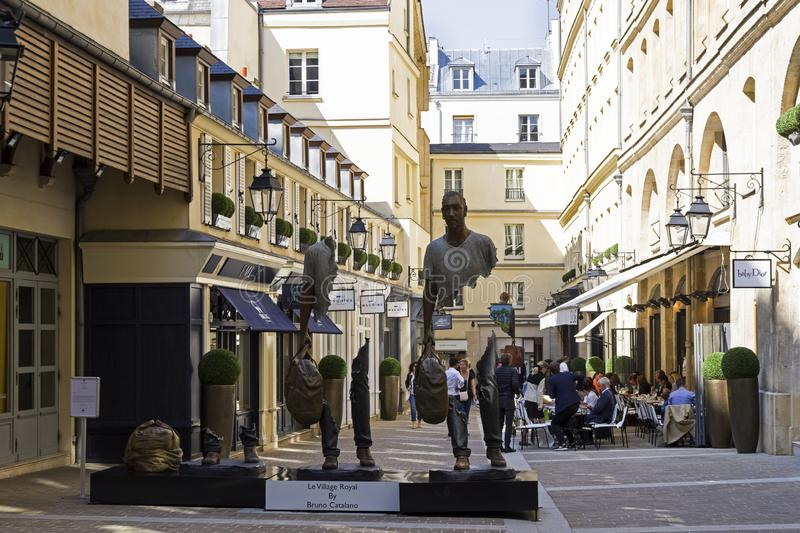 Unusual sculpture in the center of Paris. Paris, France - September 3, 2018: Street exposure of the artworks of Bruno Catalano on the Parisian shopping street Le royalty free stock images