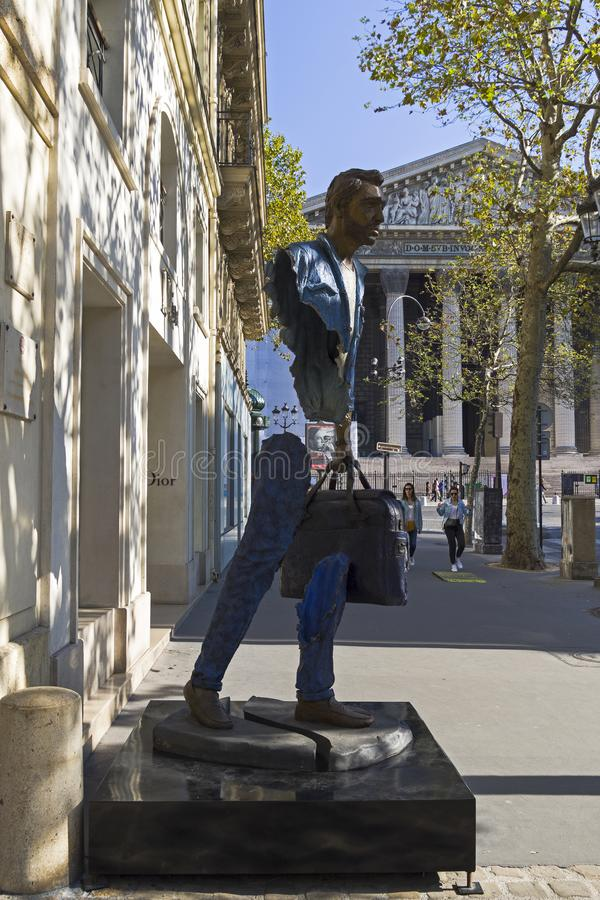 Unusual sculpture in the center of Paris. Paris, France - September 2, 2018: Street exposure of the artworks of Bruno Catalano on the Parisian shopping street Le royalty free stock images
