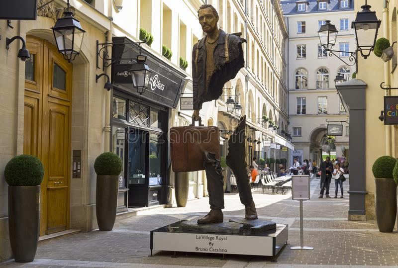 Unusual sculpture in the center of Paris. Paris, France - September 3, 2018: Street exposure of the artworks of Bruno Catalano on the Parisian shopping street Le stock photography