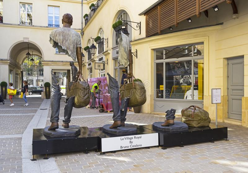 Unusual sculpture in the center of Paris. Paris, France - September 3, 2018: Street exposure of the artworks of Bruno Catalano on the Parisian shopping street Le stock images
